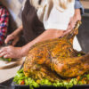grandparents-with-granddaughter-cooking-turkey_23-2147947832