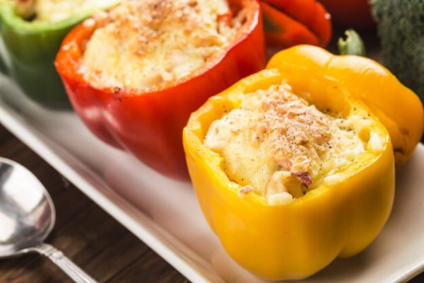 Seafood rice with cheese, stuffed peppers with rice and minced m